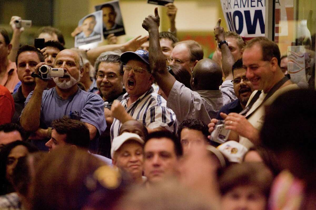 An irate crowd member shouts out against Congress woman Shelia Jackson Lee during a town hall style meeting on health care reform at the Northeast Multi-Service Center, Wednesday, August 12, 2009.