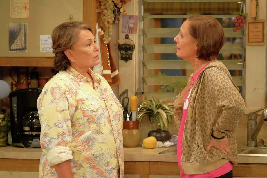 "In this image released by ABC, Roseanne Barr, left, and Laurie Metcalf appear in a scene from the reboot of the popular comedy series ""Roseanne.""  18.4 million viewers tuned in for its premiere. (Adam Rose/ABC via AP) Photo: Adam Rose / © 2017 American Broadcasting Companies, Inc. All rights reserved"