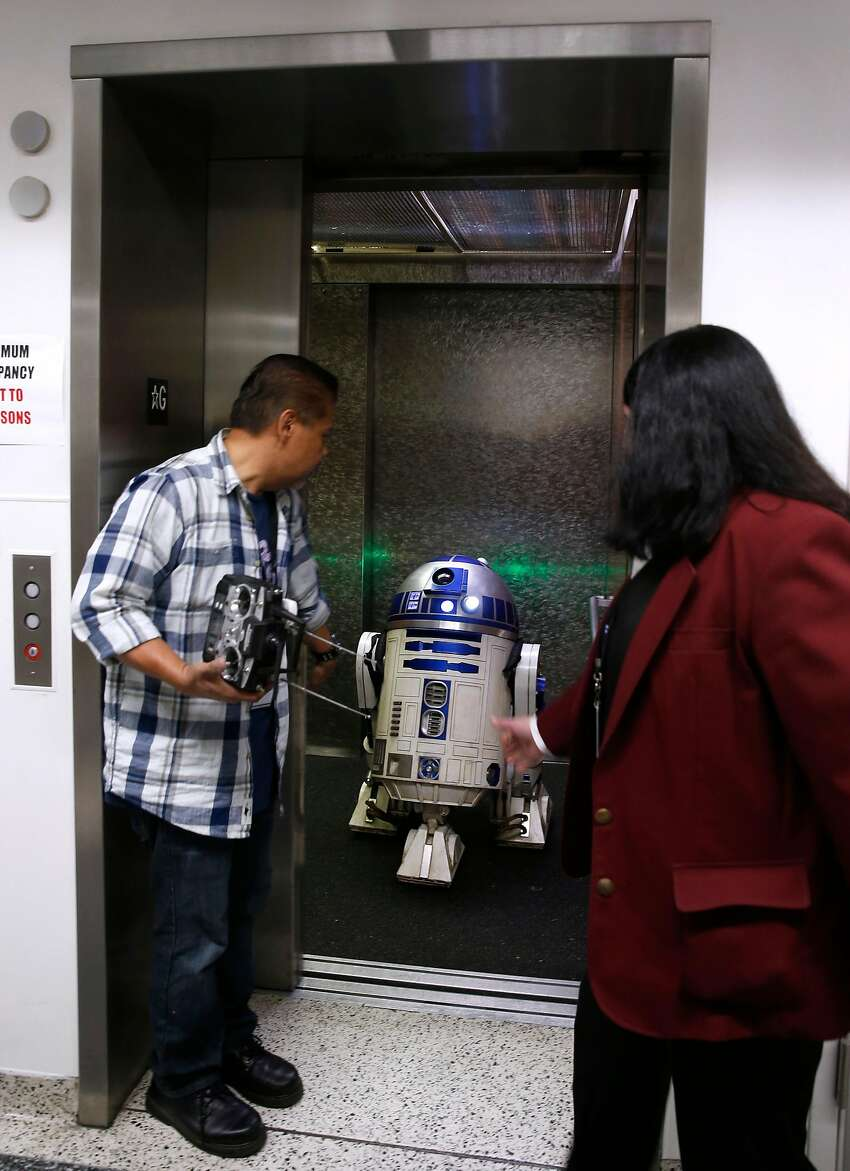 R2D2 rolls out of an elevator at the Silicon Valley Comic Con in San Jose, Calif. on Saturday, April 7, 2018.