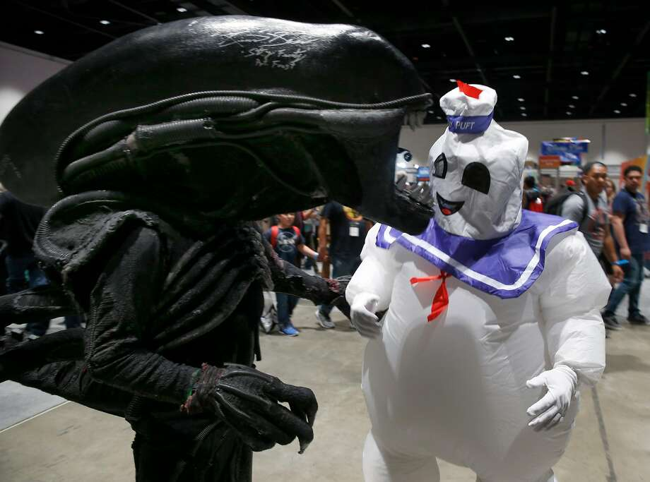 The Alien (Matthew O'Connor) and the Stay Puft Marsh mal low Man (Les Marmo) meet at Comic Con on Saturday, April 7. Photo: Paul Chinn / The Chronicle