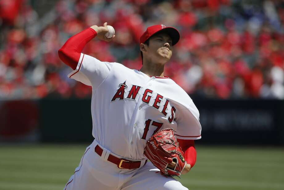Los Angeles Angels starting pitcher Shohei Ohtani, of Japan, throws against the Oakland Athletics during the first inning of a baseball game, Sunday, April 8, 2018, in Anaheim, Calif. (AP Photo/Jae C. Hong) Photo: Jae C. Hong / Associated Press