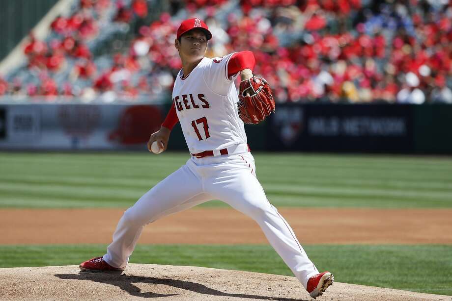 Los Angeles Angels starting pitcher Shohei Ohtani, of Japan, throws against the Oakland Athletics during the first inning of a baseball game, Sunday, April 8, 2018, in Anaheim, Calif. (AP Photo/Jae C. Hong) Photo: Jae C. Hong, Associated Press