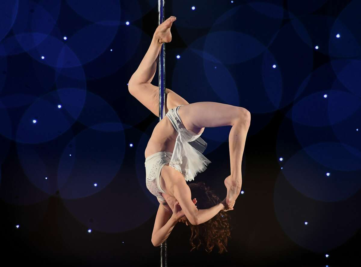 This multiple exposure shows Phoenix as she competes in the 2018 Pacific Pole Championships at the Convention Center in Los Angeles, California on April 7, 2018. Combining dance and acrobatics, originally began as entertainment in strip clubs, pole dancing soon became mainstream as a form of exercise and expression. Competitions are now held in countries throughout the world and has a participant level estimated at over 30,000 in the US.