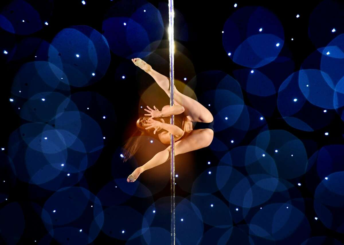 This multiple exposure shows Dana Martell as she competes in the 2018 Pacific Pole Championships at the Convention Center in Los Angeles, California on April 7, 2018. Combining dance and acrobatics, originally began as entertainment in strip clubs, pole dancing soon became mainstream as a form of exercise and expression. Competitions are now held in countries throughout the world and has a participant level estimated at over 30,000 in the US.