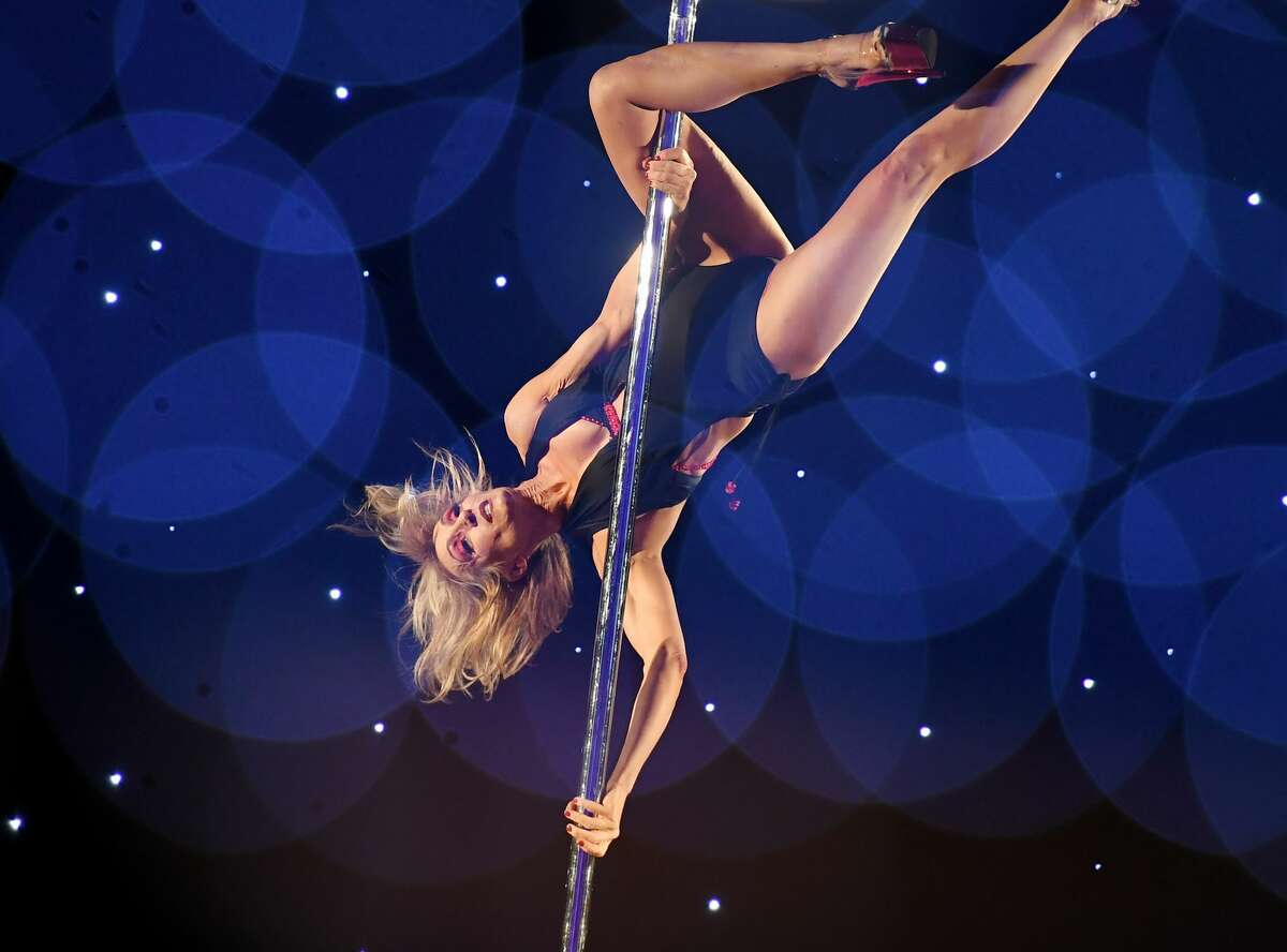 This multiple exposure shows Patty Yaconis as she competes in the 2018 Pacific Pole Championships at the Convention Center in Los Angeles, California on April 7, 2018. Combining dance and acrobatics, originally began as entertainment in strip clubs, pole dancing soon became mainstream as a form of exercise and expression. Competitions are now held in countries throughout the world and has a participant level estimated at over 30,000 in the US.