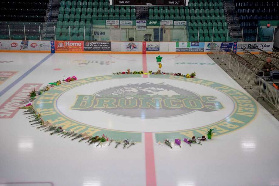 Flowers are shown at center ice as preparations are made at Elgar Petersen Arena for a vigil tonight in Humboldt, Saskatchewan, Sunday, April 8, 2018. Multiple people traveling with the Humboldt Broncos SJHL hockey team are dead, and many injured when their bus was collided with a semi-trailer north of Tisdale, Saskatchewan. (Liam Richards/The Canadian Press via AP) Photo: Liam Richards / The Canadian Press
