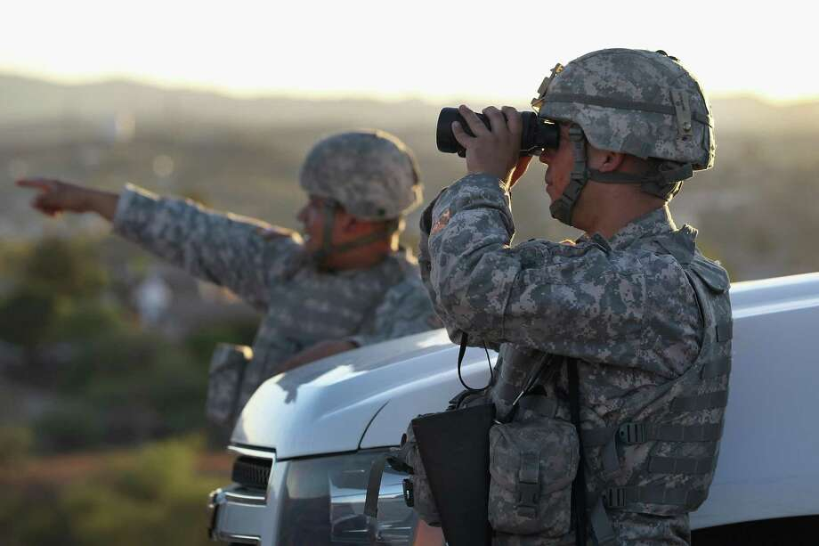 FILE PHOTO: U.S. Army National Guardsmen scan the U.S.-Mexico border on June 22, 2011 in Nogales, Arizona. Photo: John Moore, Staff / Getty Images / 2011 Getty Images