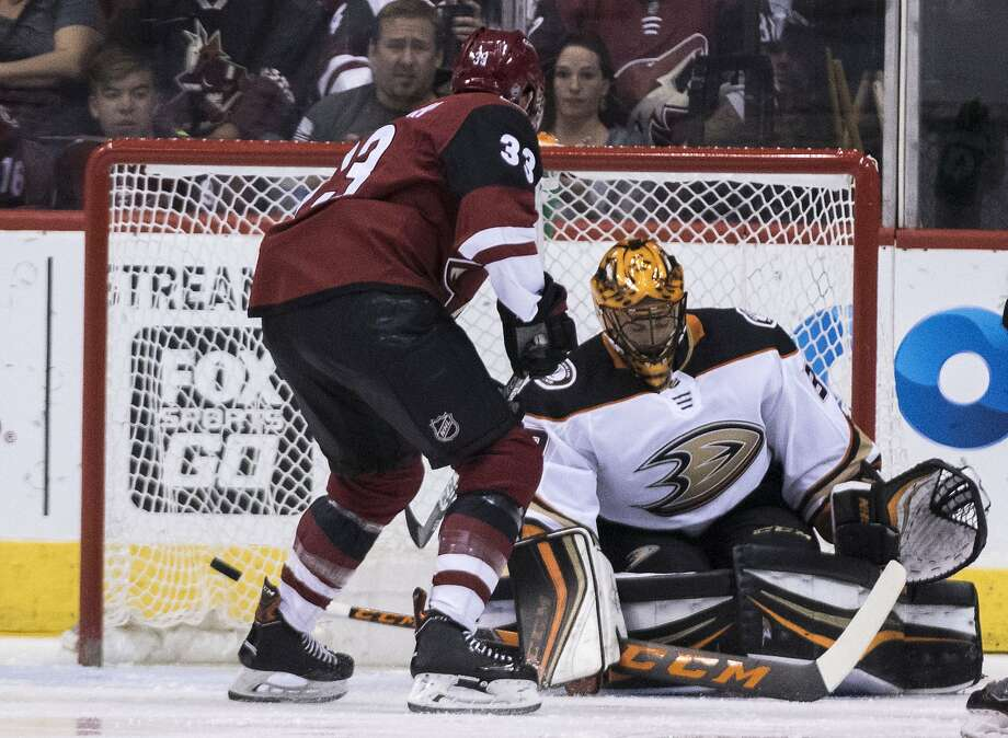 The Sharks' first-round target will be Anaheim goalie Ryan Miller, who makes a save Saturday. Photo: Darryl Webb / Associated Press