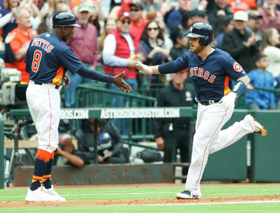Houston Astros catcher Max Stassi (12) rounds third past  third base coach Gary Pettis (8) after hitting a 3-run home run off of San Diego Padres starting pitcher Tyson Ross during the fifth inning of a major league baseball game at Minute Maid Park on Sunday, April 8, 2018, in Houston. ( Brett Coomer / Houston Chronicle ) Photo: Brett Coomer, Staff / © 2018 Houston Chronicle