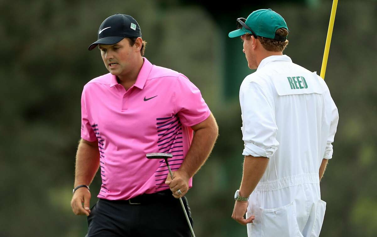 AUGUSTA, GA - APRIL 08: Patrick Reed of the United States and caddie Kessler Karain react on the 17th green during the final round of the 2018 Masters Tournament at Augusta National Golf Club on April 8, 2018 in Augusta, Georgia. (Photo by Andrew Redington/Getty Images)