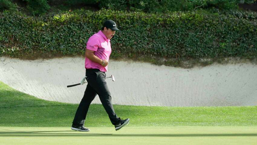 Patrick Reed reacts to his birdie on the 12th hole during the fourth round at the Masters golf tournament Sunday, April 8, 2018, in Augusta, Ga.