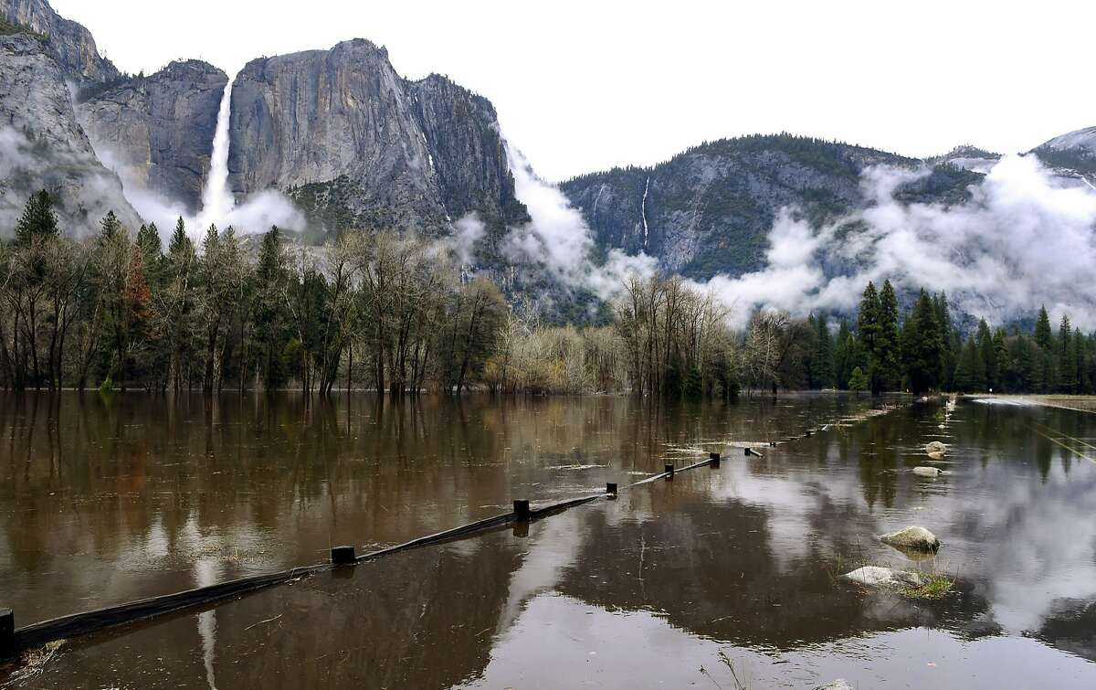 Cook's Meadow is flooded by the rising Merced River in Yosemite National Park's Yosemite Valley on Saturday, April 7, 2018. Northern California was drenched by a powerful
