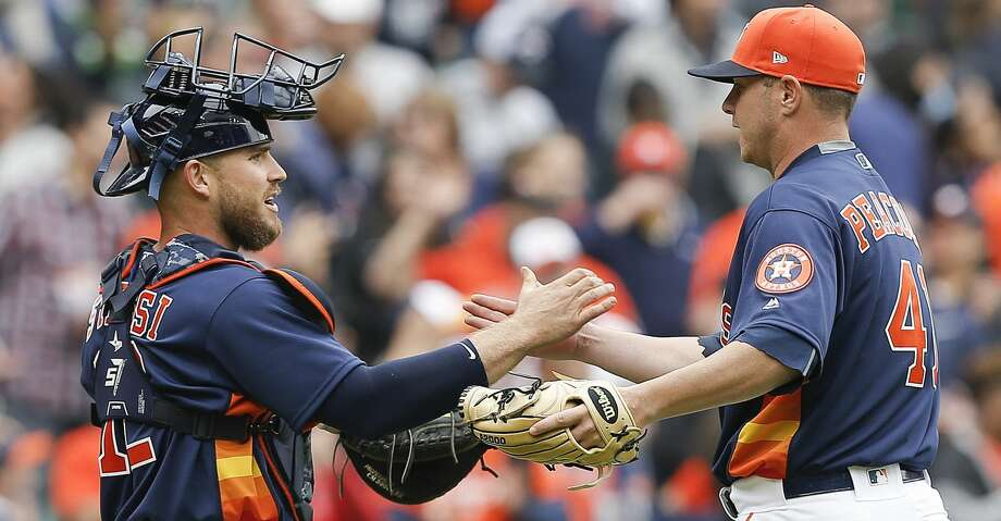 HOUSTON, TX - APRIL 08:  Brad Peacock #41 of the Houston Astros shakes hands with Max Stassi #12 after the final out against the San Diego Padres at Minute Maid Park on April 8, 2018 in Houston, Texas.  (Photo by Bob Levey/Getty Images) Photo: Bob Levey/Getty Images