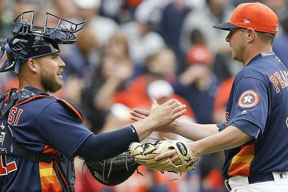 HOUSTON, TX - APRIL 08:  Brad Peacock #41 of the Houston Astros shakes hands with Max Stassi #12 after the final out against the San Diego Padres at Minute Maid Park on April 8, 2018 in Houston, Texas.  (Photo by Bob Levey/Getty Images)