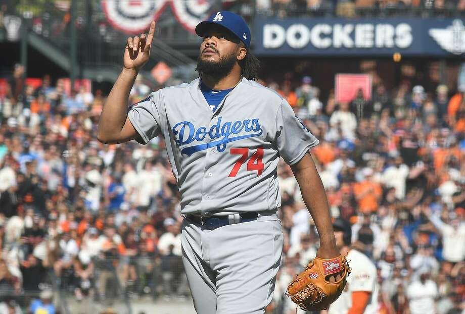 SAN FRANCISCO, CA - APRIL 08:  Kenley Jansen #74 of the Los Angeles Dodgers celebrates after striking out Brandon Belt #9 of the San Francisco Giants for the final out of the game at AT&T Park on April 8, 2018 in San Francisco, California. The Dodgers won the game in extra inning 2-1.  (Photo by Thearon W. Henderson/Getty Images) Photo: Thearon W. Henderson / Getty Images