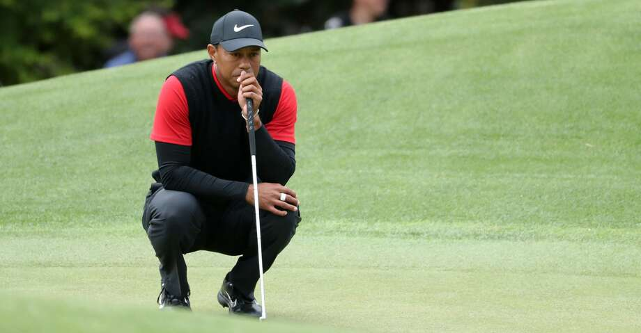 Tiger Woods lines up his putt on eight during the final round of the Masters at Augusta National Golf Club on Sunday, April 8, 2018, in Augusta, Ga. (Curtis Compton/Atlanta Journal-Constitution/TNS) Photo: Curtis Compton/TNS