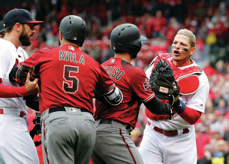 Cardinals catcher Yadier Molina (right) is held back by the Diamondbacks' Daniel Descalso as Diamondback Alex Avila (5) gets between them and Cardinals' Matt Carpenter (left) during an altercation in the second inning Sunday at Busch Stadium. Photo: Associated Press
