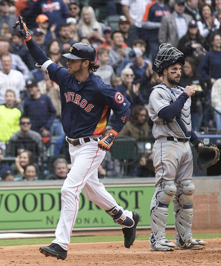Houston Astros right fielder Josh Reddick (22) points to the sky as he runs past San Diego Padres catcher Austin Hedges (18) after hitting a solo home run during the sixth inning of a major league baseball game at Minute Maid Park on Sunday, April 8, 2018, in Houston. ( Brett Coomer / Houston Chronicle ) Photo: Brett Coomer, Houston Chronicle