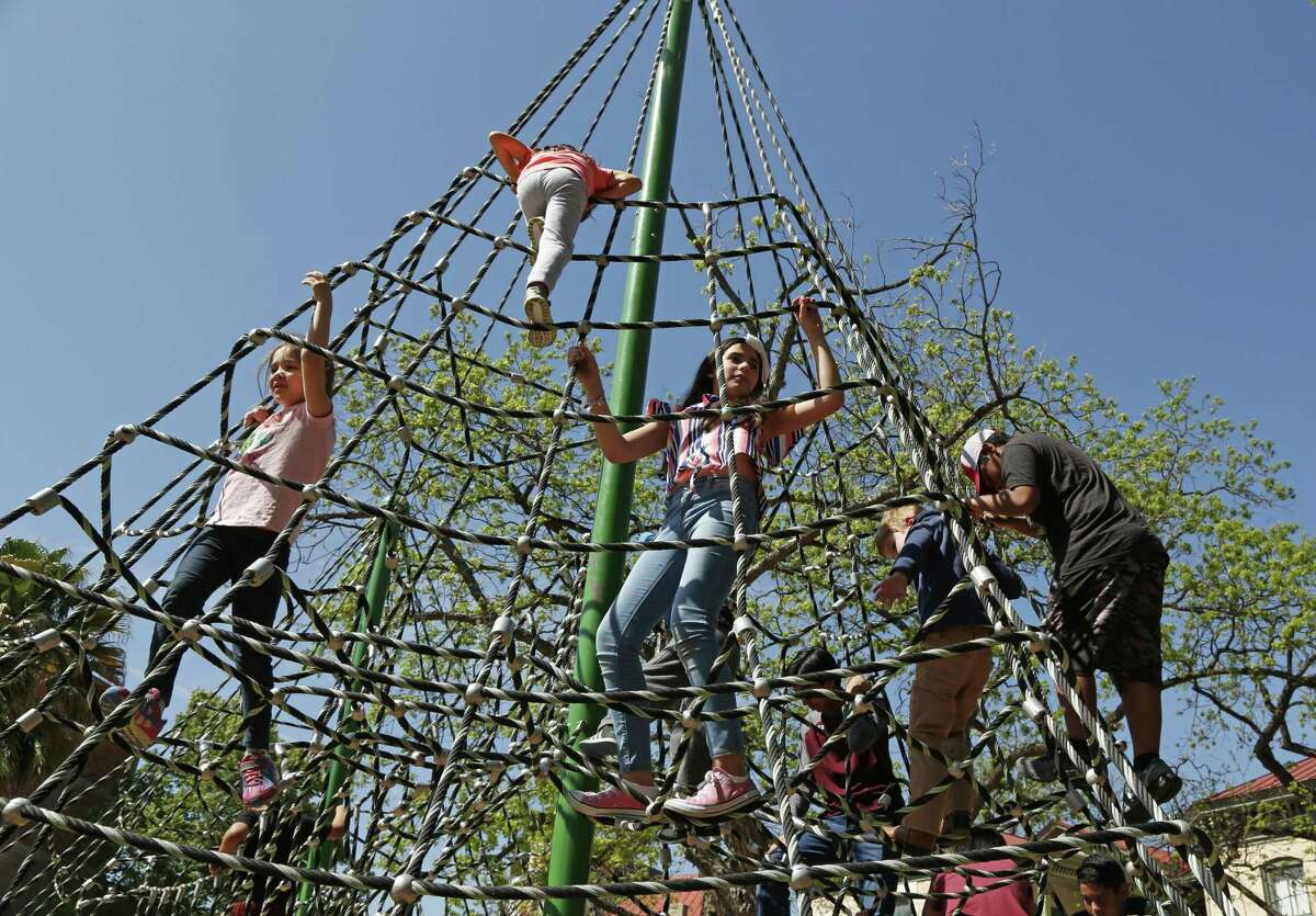 Children take advance of the beautiful day to play on the grounds. Hemisfair is celebrating its 50th anniversary with a weekend Tricentennial event of music performances and art exhibitions. On Sunday, the Mexican Cultural Institute will have a