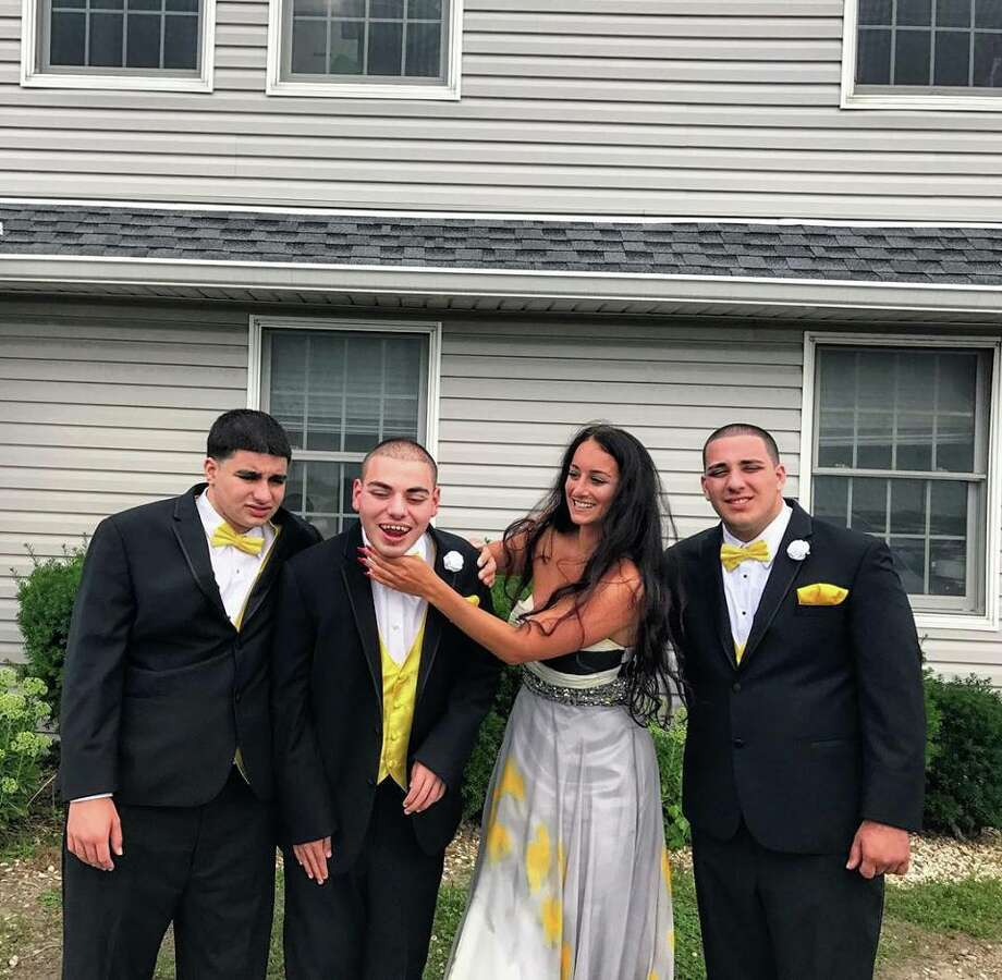 Ali Carbone and her three brothers, all of whom have autism. Photo: Courtesy Via Frank Somerville