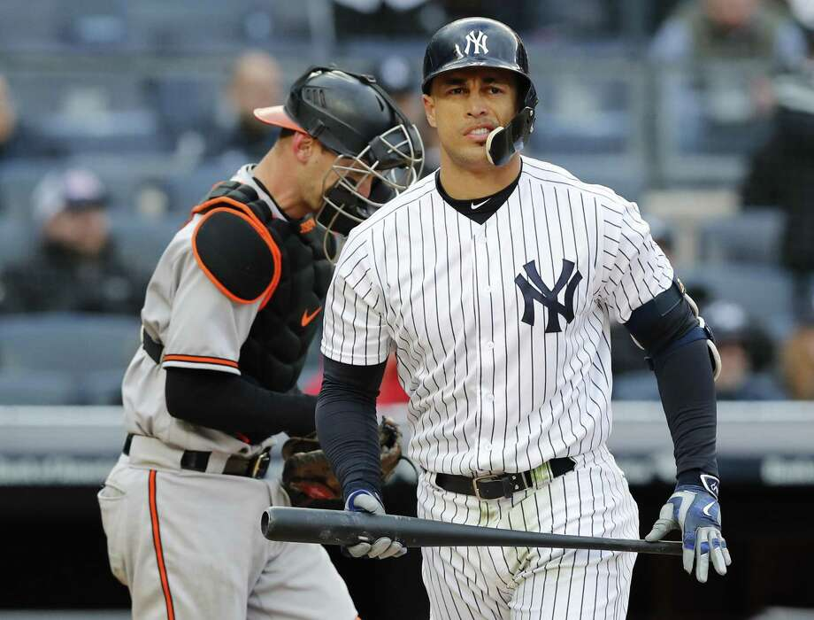 The Yankees' Giancarlo Stanton reacts after he stuck out stranding two runners for the final out during the 12th inning against the Orioles on Sunday in New York. Orioles catcher Caleb Joseph is at left. (AP Photo/Kathy Willens) Photo: Kathy Willens / Associated Press / Associated Press