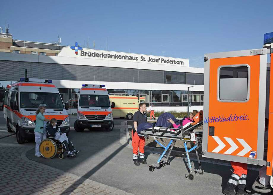 Persons are transported from the St. Josef hospital to other hospitals in Paderborn, Germany, Sunday, April 8, 2018. More than 26,000 people were asked to leave their homes in the western German town of Paderborn, two hospitals, a university and several nursing homes were evacuated so specialists could remove a World War II-era bomb discovered during construction work. (Henning Kaiser/dpa via AP) Photo: Henning Kaiser / dpa