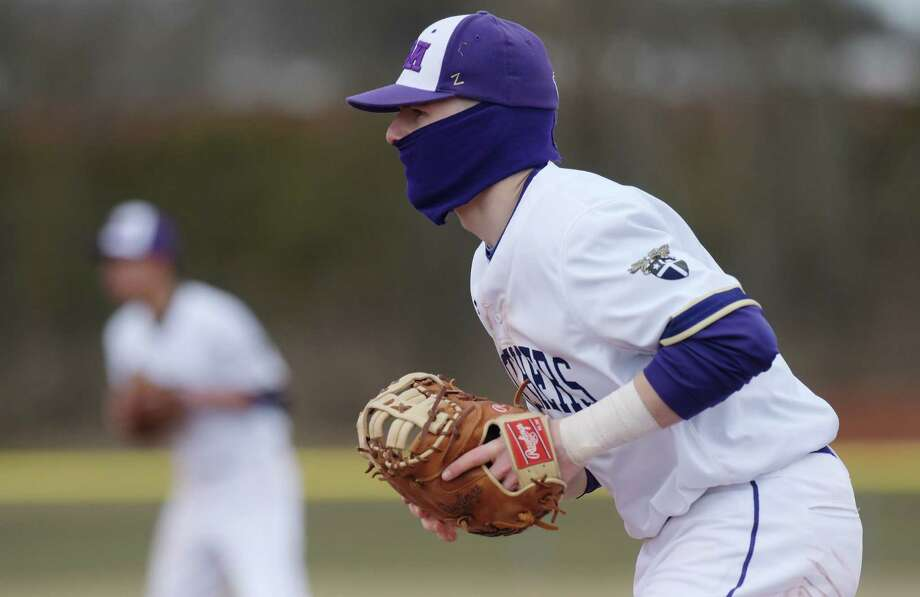 Peter O'Toole of Christian Brothers Academy wears a face mask to try and stay warm during the Christian Brothers Academy and Ballston Spa High School baseball game on Thursday, April 5, 2018, in Albany, N.Y.    (Paul Buckowski/Times Union) Photo: PAUL BUCKOWSKI / (Paul Buckowski/Times Union)
