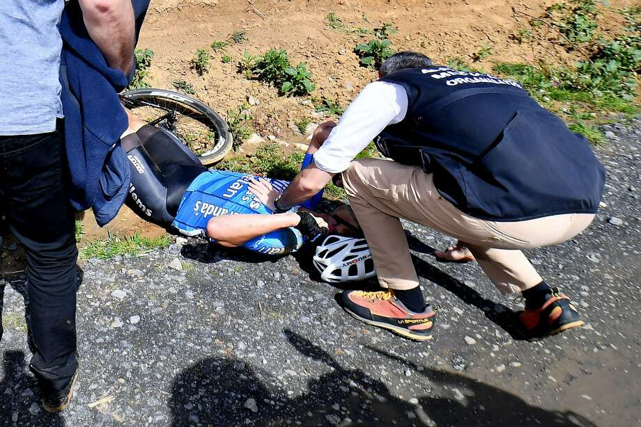 Belgium's Michael Goolaerts of Veranda's Willems-Crelan cycling team receives first aid after a crash during the 116th edition of the Paris-Roubaix one-day classic cycling race, between Compiegne and Roubaix, on April 8, 2018 near Viesly, northern France.  Photo: DAVID STOCKMAN, AFP/Getty Images