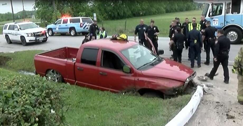 Two people were injured Sunday near Lake Conroe when authorities chased a stolen pickup until it crashed into a concrete ditch.