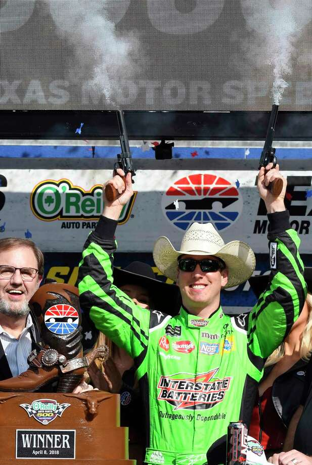 Kyle Busch celebrates in Victory Lane after winning a NASCAR Cup Series auto race in Fort Worth, Texas, Sunday, April 8, 2018. (AP Photo/Larry Papke) Photo: Larry Papke / FR58581 AP