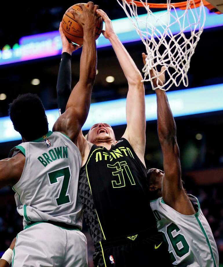 Boston Celtics' Jaylen Brown (7) battles Atlanta Hawks' Mike Muscala (31) for a rebound during the first quarter of an NBA basketball game in Boston, Sunday, April 8, 2018. (AP Photo/Michael Dwyer) Photo: Michael Dwyer / AP2018