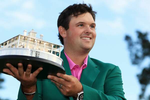 AUGUSTA, GA - APRIL 08:  Patrick Reed of the United States celebrates with the trophy during the green jacket ceremony after winning the 2018 Masters Tournament at Augusta National Golf Club on April 8, 2018 in Augusta, Georgia.  (Photo by Andrew Redington/Getty Images)