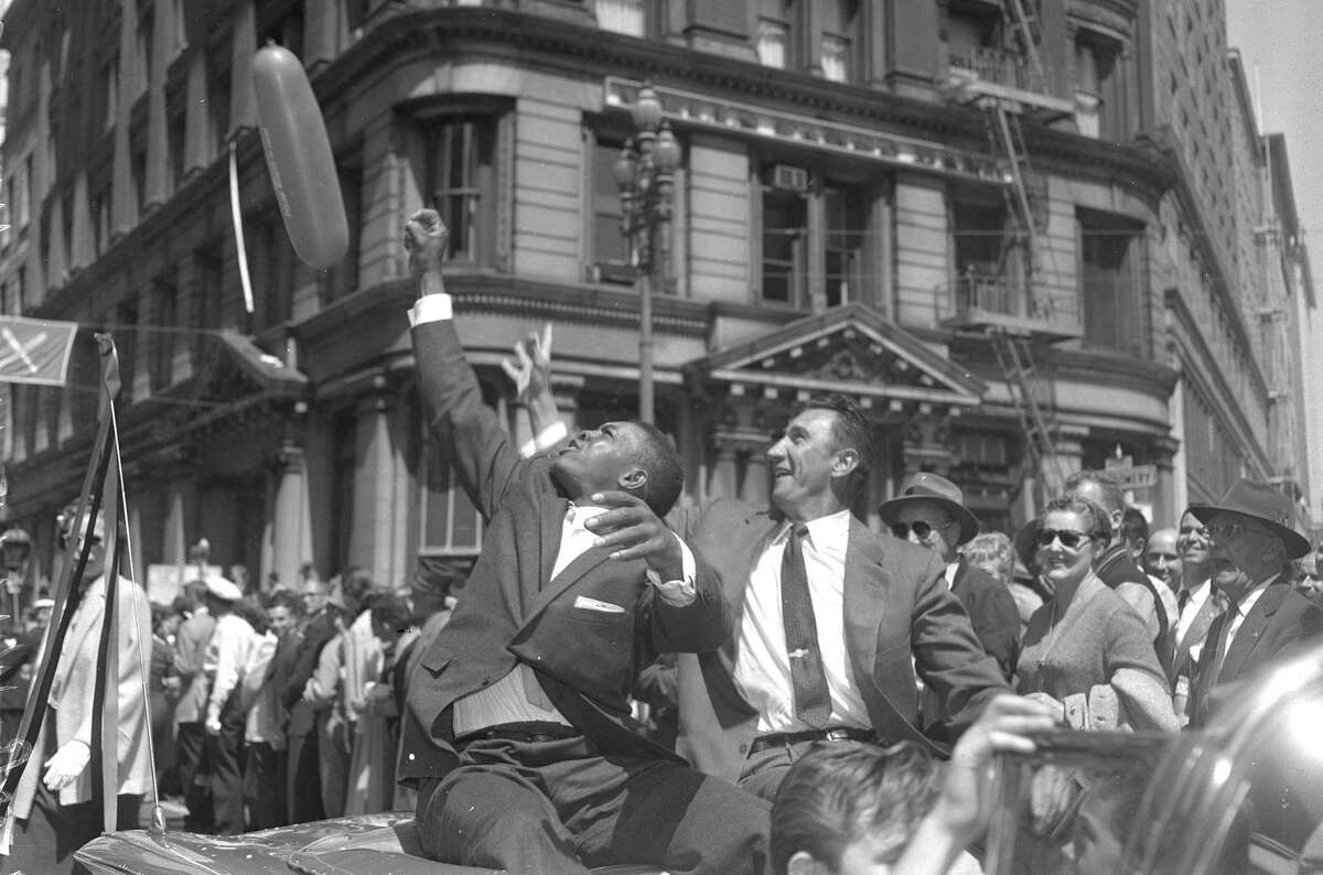 Outfielders Willie Mays and Hank Sauer ride in the parade to welcome the Giants to San Francisco in 1958.