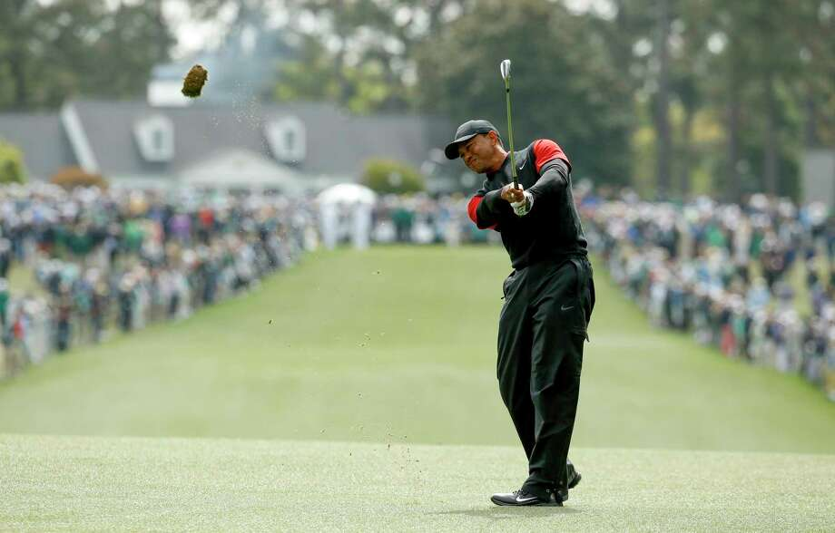Tiger Woods hits on the first fairway during the fourth round at the Masters golf tournament Sunday, April 8, 2018, in Augusta, Ga. (AP Photo/Charlie Riedel) Photo: Charlie Riedel / Copyright 2018 The Associated Press. All rights reserved.