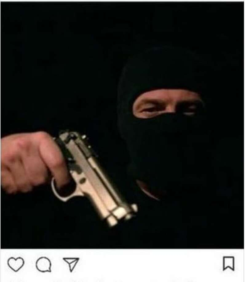 An Instagram post that threatened a Meyerland Middle School featured what appears to be a stock image of a man with a gun.