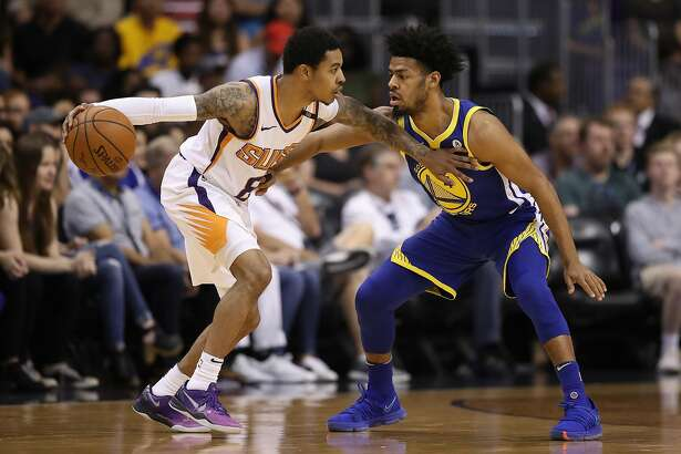 PHOENIX, AZ - APRIL 08: Tyler Ulis #8 of the Phoenix Suns handles the ball under pressure from Quinn Cook #4 of the Golden State Warriors during the first half of the NBA game at Talking Stick Resort Arena on April 8, 2018 in Phoenix, Arizona. NOTE TO USER: User expressly acknowledges and agrees that, by downloading and or using this photograph, User is consenting to the terms and conditions of the Getty Images License Agreement. (Photo by Christian Petersen/Getty Images)