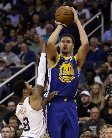 3e8cf0c9038 Golden State Warriors guard Klay Thompson (11) shoots over Phoenix Suns  guard Tyler Ulis