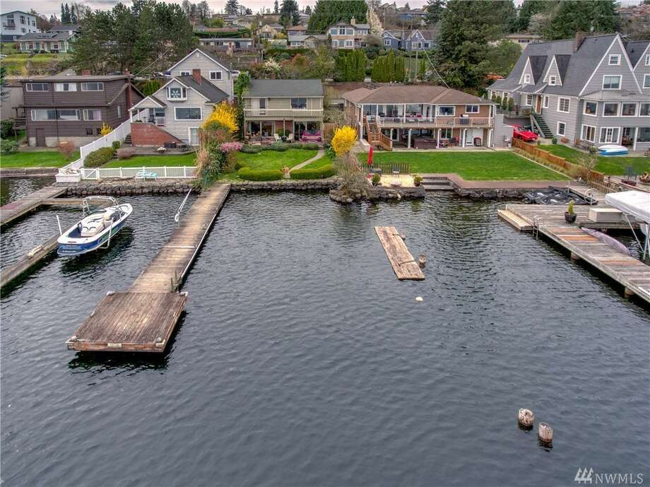 A timewarp inside, but all opportunity outside, this home on Lake Washington could be yours to make brand new. Photo: Rebecca Nadesan, Ian Macrae/Coldwell Banker