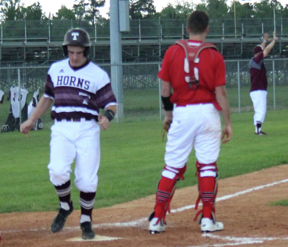 Tarkington Longhorn Trae Deck (22) makes it home to score a run for the team against the Cleveland Indians on April 3. Photo: Jacob McAdams