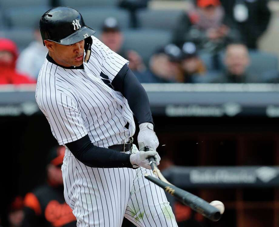 New York Yankees' Giancarlo Stanton breaks his bat as he grounded into a fielder's choice in the 10th inning of a baseball game against the Baltimore Orioles in New York, Sunday, April 8, 2018. (AP Photo/Kathy Willens) Photo: Kathy Willens / Associated Press