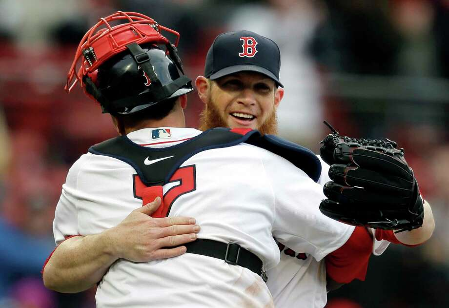 Boston Red Sox's Christian Vazquez, left, celebrates with relief pitcher Craig Kimbrel, right, after they defeated the Tampa Bay Rays in a baseball game, Sunday, April 8, 2018, in Boston. (AP Photo/Steven Senne) Photo: Steven Senne / Copyright 2018 The Associated Press. All rights reserved.