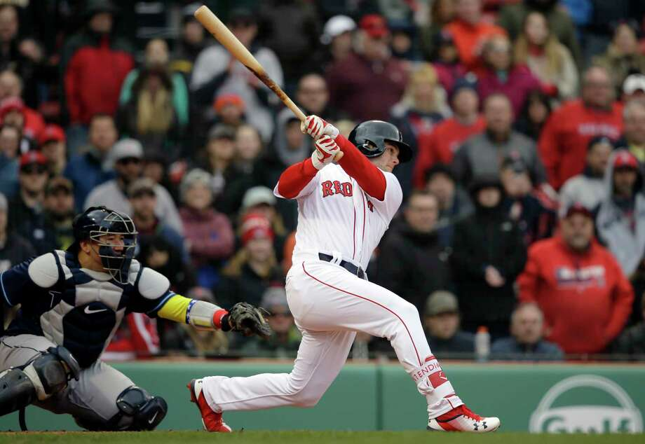 Boston Red Sox's Andrew Benintendi, right, hits an RBI-double as Tampa Bay Rays catcher Jesus Sucre, left, looks on in the eighth inning of a baseball game, Sunday, April 8, 2018, in Boston. (AP Photo/Steven Senne) Photo: Steven Senne / Copyright 2018 The Associated Press. All rights reserved.