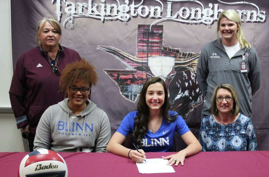 Tarkington High School volleyball star Chloe Mullins (middle) signs her name on April 5 to play for the Blinn College Buccaneers. Back row: Tarkington High School Softball Coach Val Weldon and Assistant Volleyball Coach Rachel Sharp. Front row: Blinn College Volleyball Coach Danielle Essix, Mullins and Tarkington High School Volleyball Coach Denise Johnson. Photo: Jacob McAdams