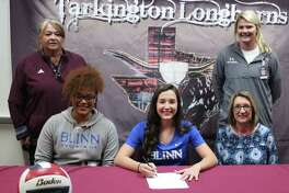 Tarkington High School volleyball star Chloe Mullins (middle) signs her name on April 5 to play for the Blinn College Buccaneers. Back row: Tarkington High School Softball Coach Val Weldon and Assistant Volleyball Coach Rachel Sharp. Front row: Blinn College Volleyball Coach Danielle Essix, Mullins and Tarkington High School Volleyball Coach Denise Johnson.