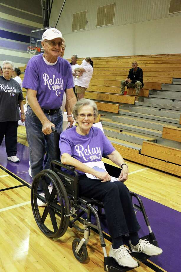 Freddie Myers participates in the Relay for Life Survivor's Lap last Friday night at Dayton High School gymnasium. She is accompanied by her husband Vohn. Both were educators in the area. Photo: David Taylor