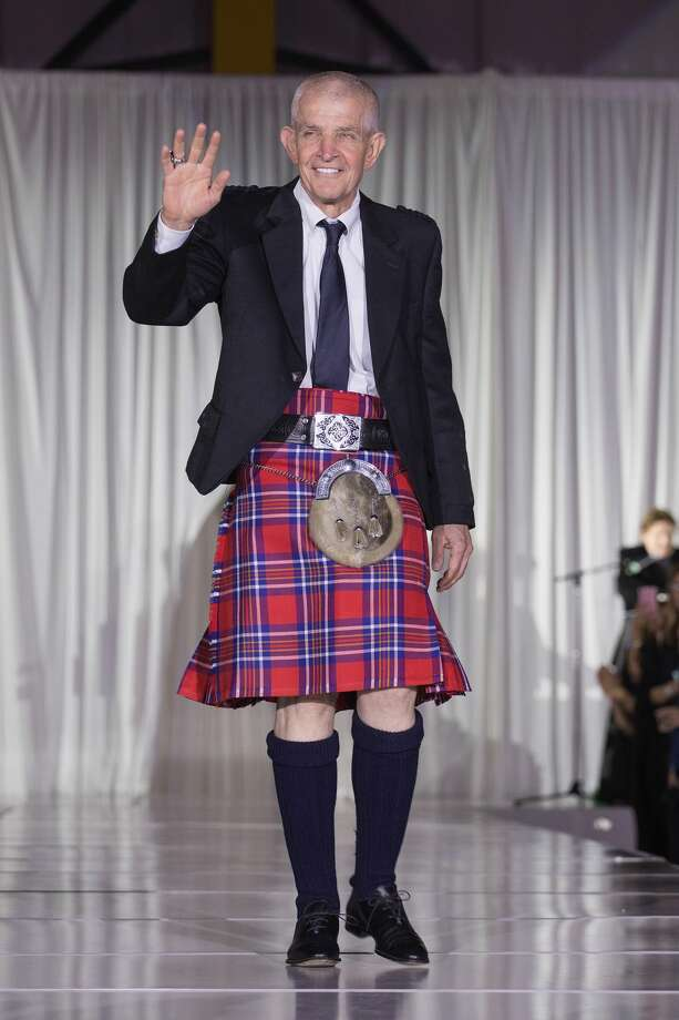 "Jim ""Mattress Mack"" McIngvale walks the runway during 'Dressed to Kilt' at Million Air Houston on April 7, 2018 in Houston, Texas. Photo: Rick Kern/Getty Images For Dressed To Kilt"
