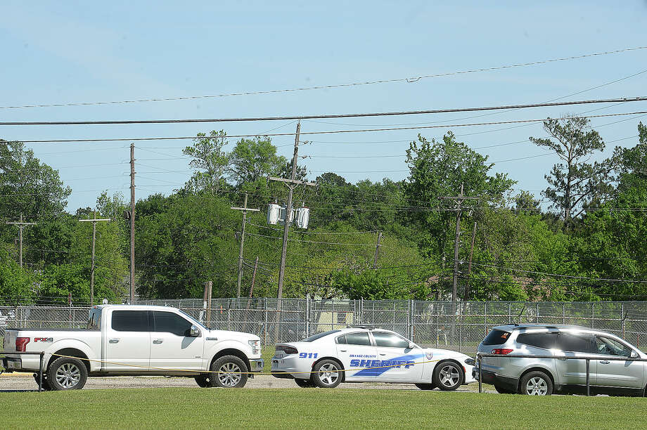 An Orange County Sheriff patrol car drives down the student pick-up line outside of Orangefield Middle School. Orangefield Elementary School. Orangefield ISD is considering the issue of allowing arms in school, particularly in light of the recent school shootings. The district, like others in the region, note their distance from law enforcement and the extended response time, which poses a further risk to students and staff in the event of an active shooter situation. Photo taken Wednesday, April 4, 2018 Kim Brent/The Enterprise Photo: Kim Brent / BEN