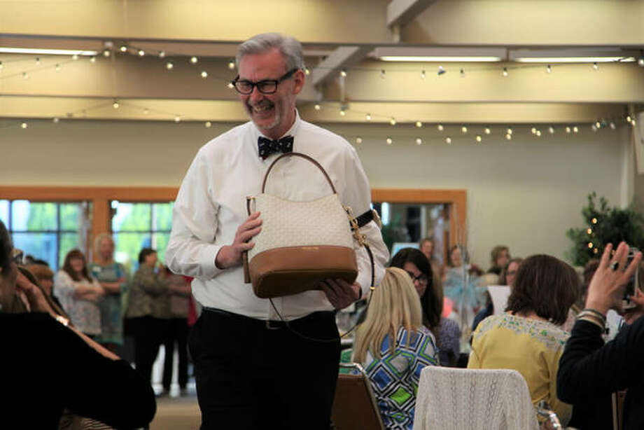 Madison County Circuit Clerk Mark Von Nida models one of the purses at last year's Power of the Purse event. Photo: For The Telegraph