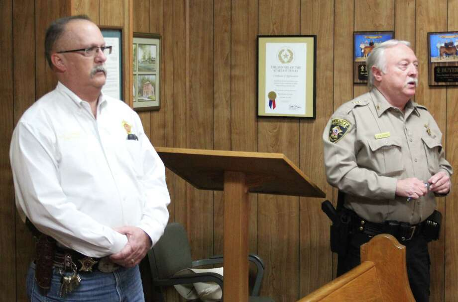 San Jacinto County Chief Deputy A. D. Todd (right) and Captain Harley Lovings (left) discuss a number of items regarding the sheriff's office at the April 4 commissioners court. All six items presented were tabled. Photo: Jacob McAdams
