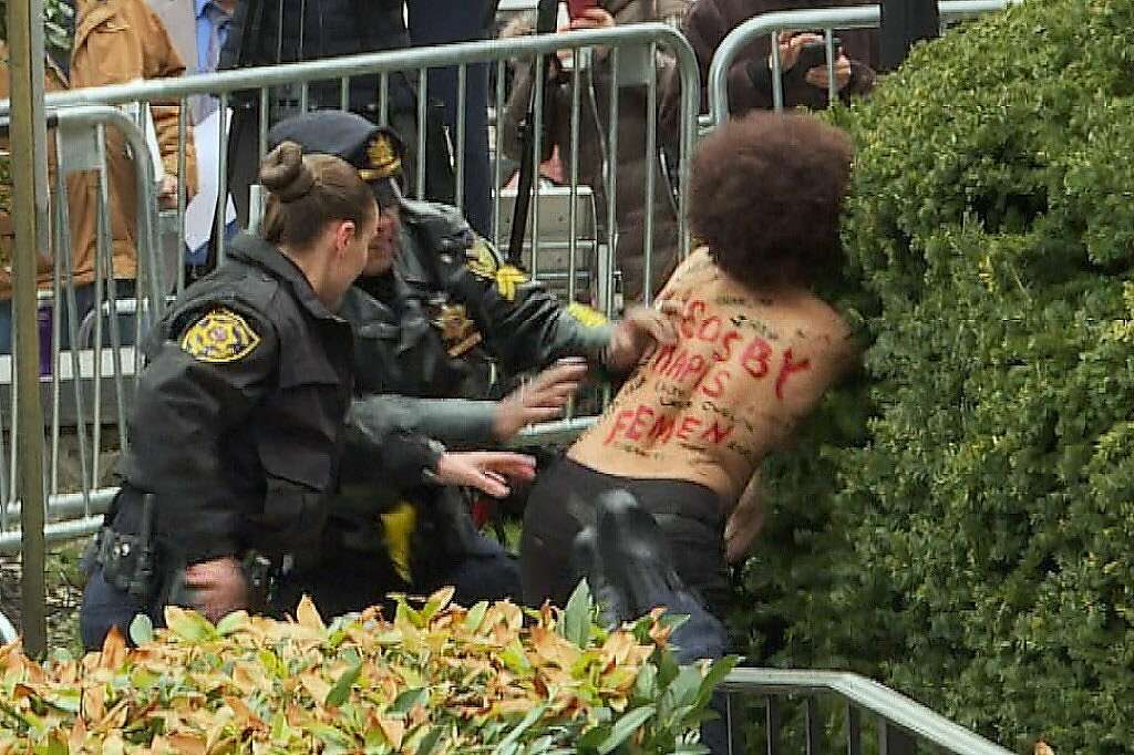 Image result for Topless protester gets close to Bill Cosby as retrial begins